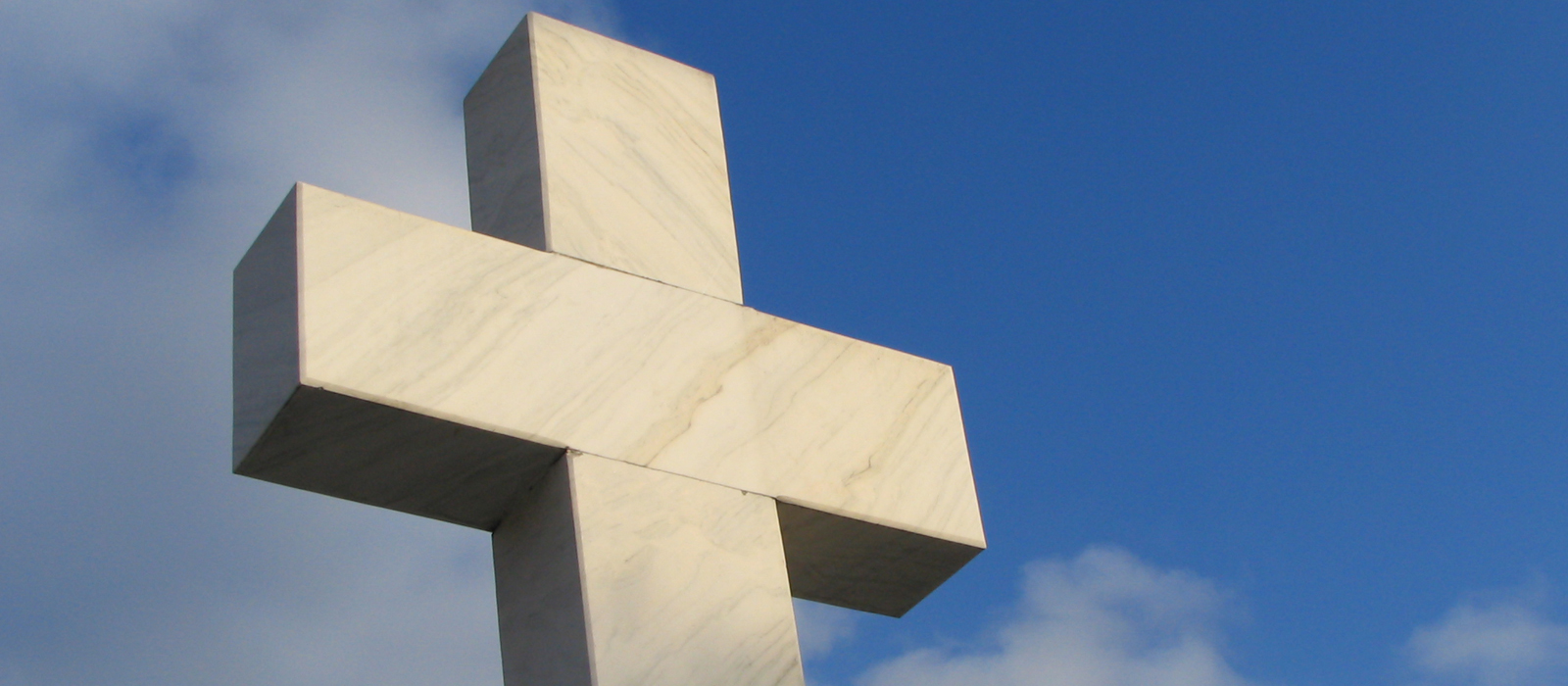 A large cross monument outside.
